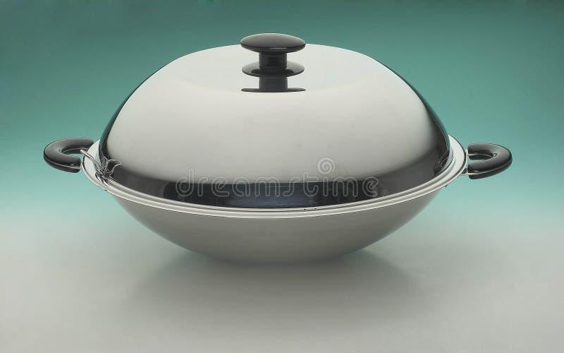 Wok. Studio shot of stainless steel covered wok stock image