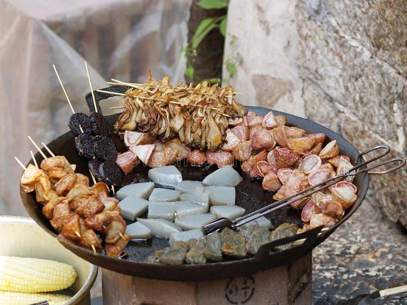 Wok food. Street food prepared in a wok stock photos