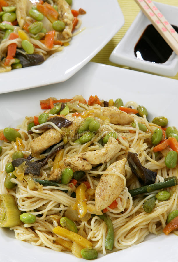 Wok food Asia. With chicken, pasta and vegetables in soybean oil royalty free stock photo