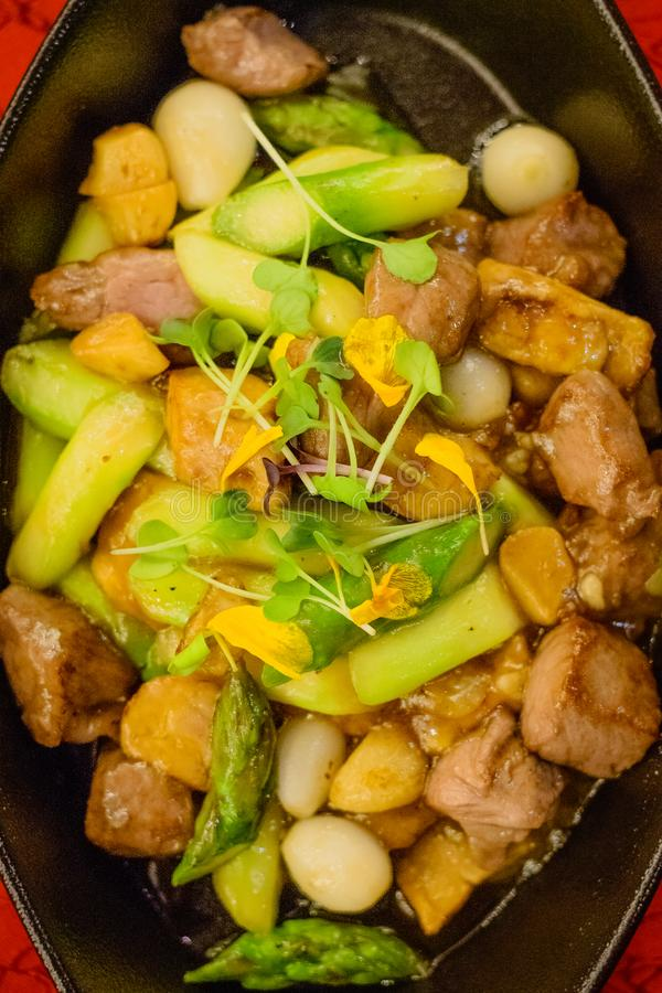 Wok-fried Australian Wagyu beef with foie gras and asparagus royalty free stock photography