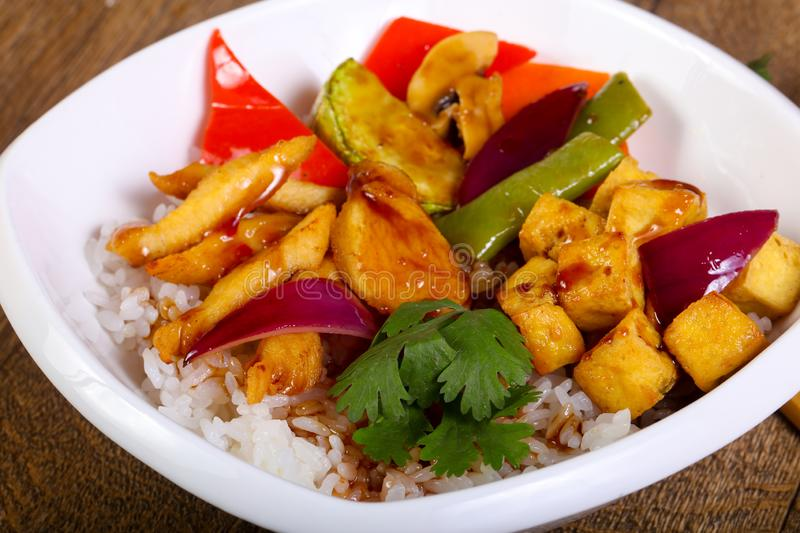 Wok with rice, cheese and tofu. Wok with rice, vegetables, cheese and tofu stock photo