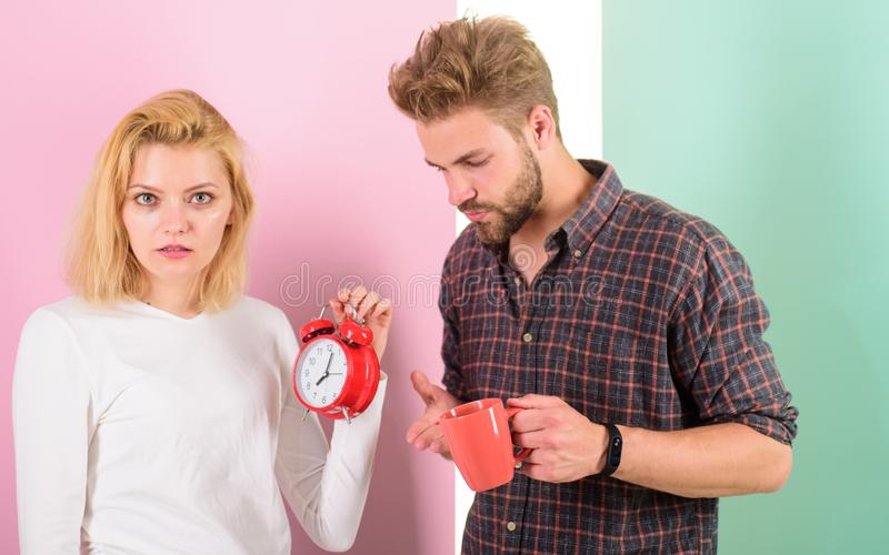 Woke up too late. I am going late for work. Couple in love overslept morning alarm clock. Woman and man sleepy tousled. Woke up too late. I am going late for stock image