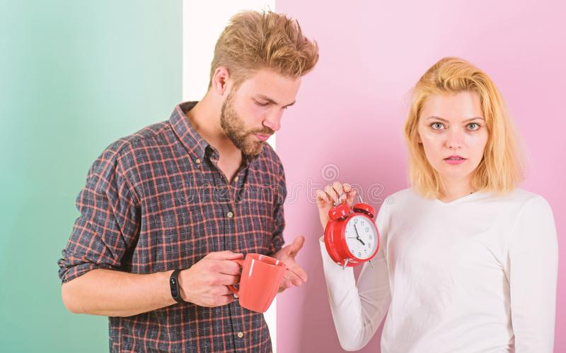 Woke up too late. I am going late for work. Couple in love overslept morning alarm clock. Woman and man sleepy tousled. Woke up too late. I am going late for stock photos