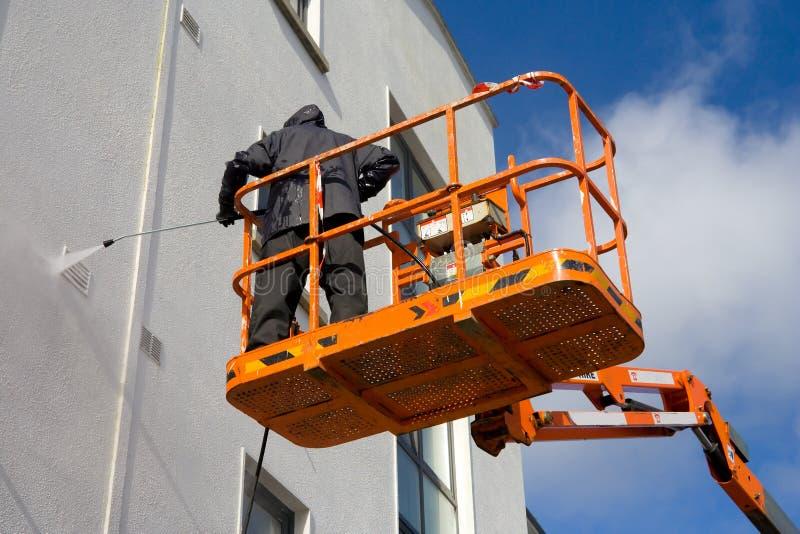 woker de lavage de plate-forme de construction image libre de droits