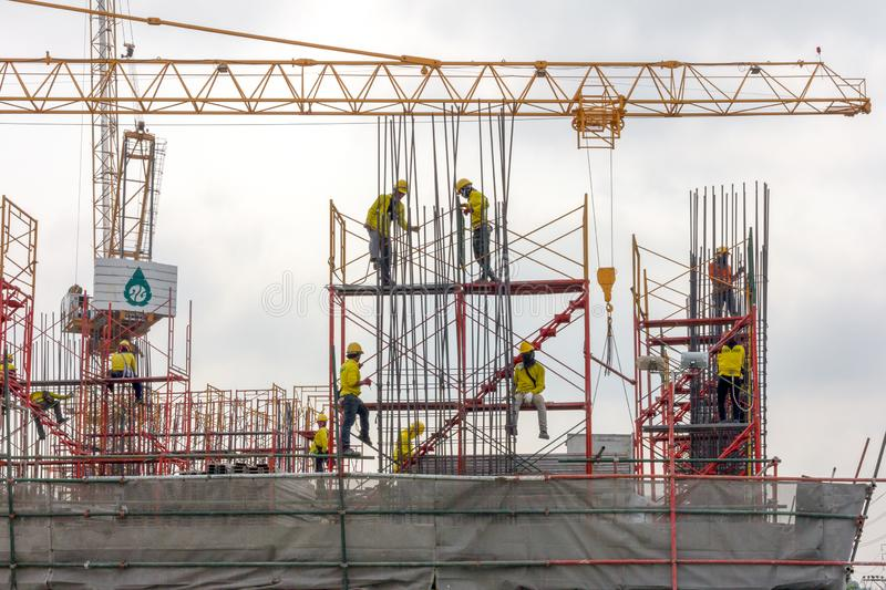 Wokers fixing concrete reinforcement rods on a construction site in Bangkok, Thailand royalty free stock photos