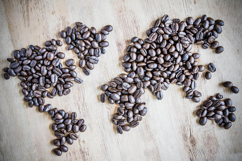 Wold map made of coffee beans on textured background royalty free stock photos