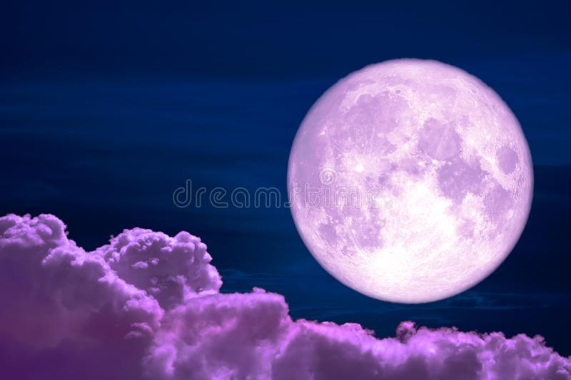 Wolf moon back on silhouette colorful heap cloud on night sky. Elements of this image furnished by NASA royalty free stock photo