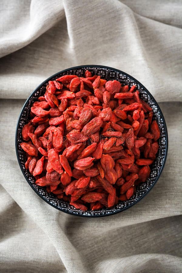 Wolfberries or Goji berries in bowl. On tablecloth.top view royalty free stock images