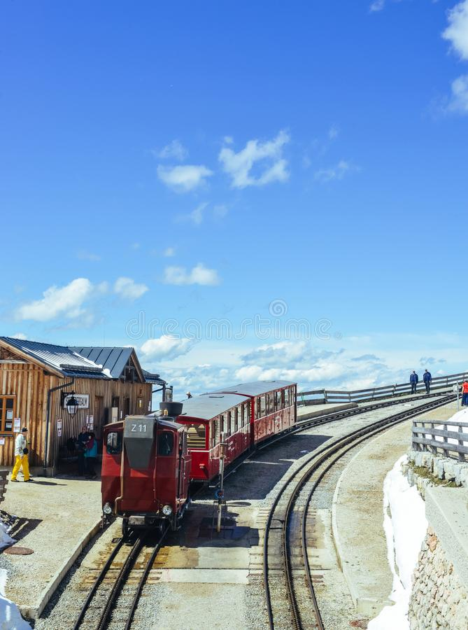 Red cable train staying in station on Schafberg mountain. Wolfgang, Austria - May 2, 2017: Single red cable train in station, Schafberg mountain the mountain in stock images