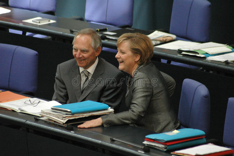 Wolfgang Schaeuble, Chancellor Angela Merkel. JUNE 29, 2006 - BERLIN: Wolfgang Schauble, Chancellor Angela Merkel during a parliamentary session in the German royalty free stock images