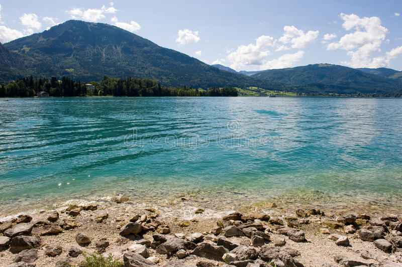 Wolfgangsee in Austria. Rocky beach of the wolfgangsee in Austria royalty free stock photo