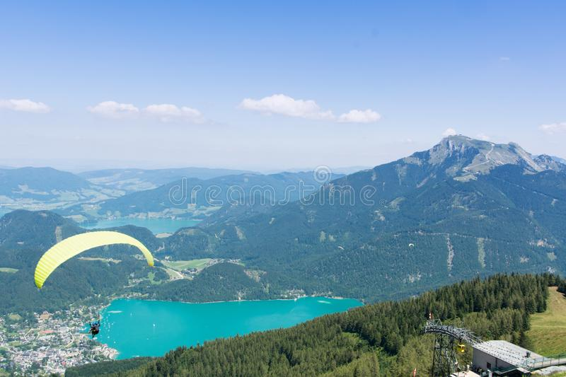 Wolfgangsee in Austria, Europe. View to the lake Wolfgangsee in Austria in the alps with paragliding man royalty free stock photo