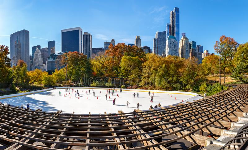 Wollman Skating Rink on a sunny morning in autumn, Central Park South and Midtown Manhattan skyscrapers. New York City stock image