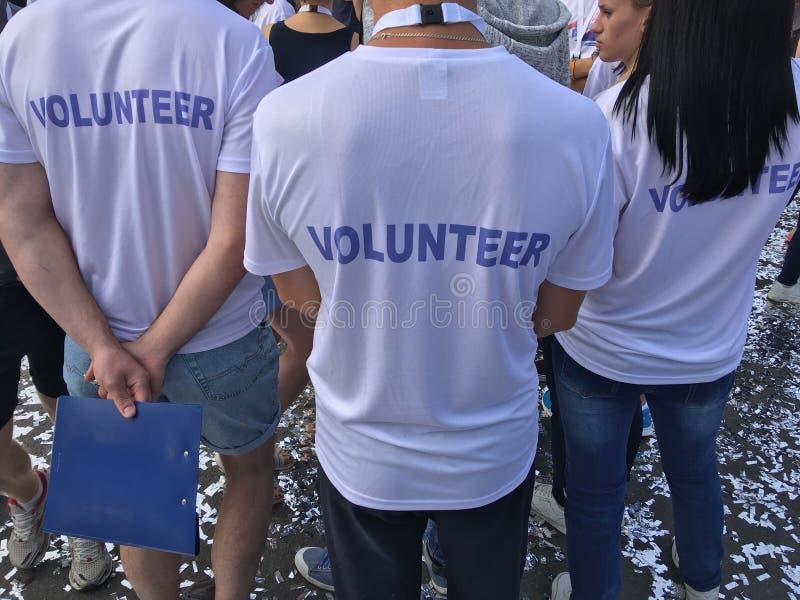 Wolontariuszi przy maratonu bieg obrazy stock