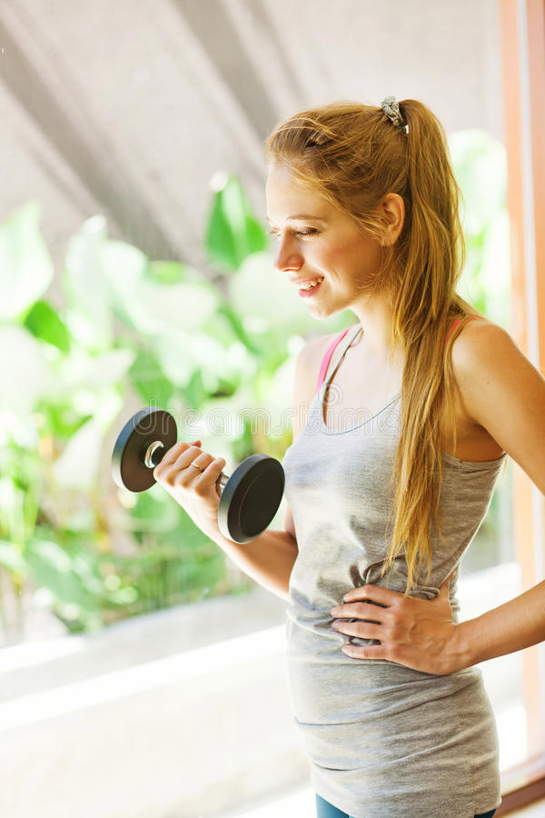 Womaan working out in gym stock photo