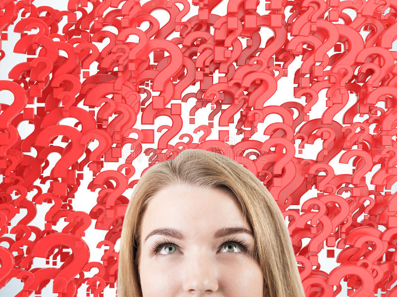 Woman's head against red question marks royalty free stock images