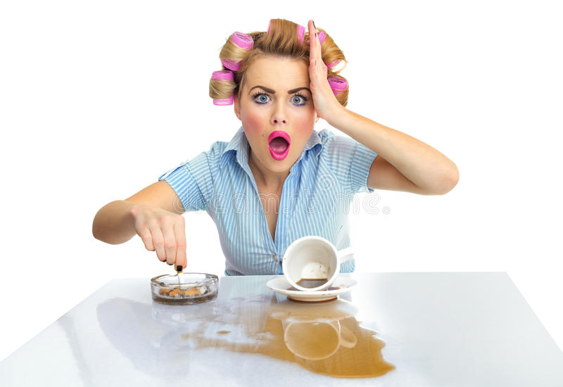Woman. Angry or agressive funny woman with cigarette and spilled coffee. Stains on desk stock photo