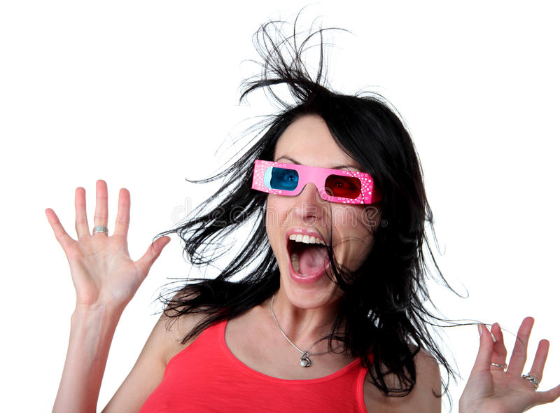 Woman in 3-d glasses with surprised expression stock photography