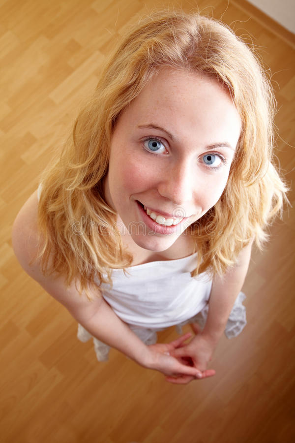 Woman from above. Full body shot of a blond woman looking up stock photography