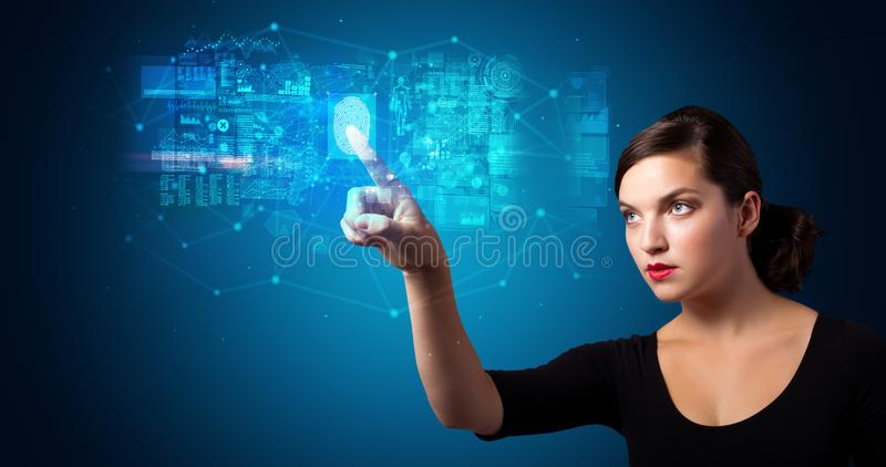 Woman accessing hologram with fingerprint stock photography