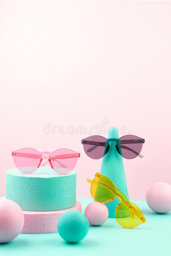 Woman accessories and geometric forms over the pink and turquoise background. Woman accessories and pastel geometric forms over the pink and turquoise background stock images