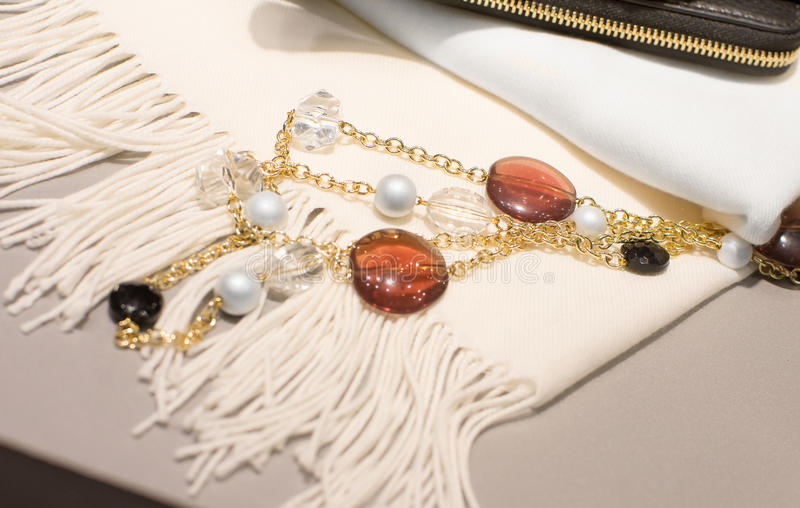 Woman accessories on a white scarf stock image