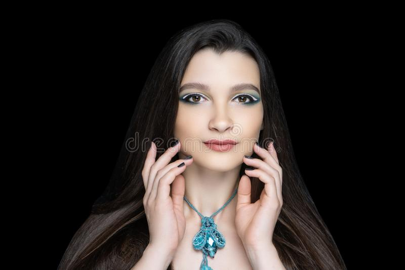 Woman accessory necklace fly. Beautiful woman close up portrait. Professional make up glossy eyeshadows, long lashes, new matte lipstick. Elegant hair style stock photos