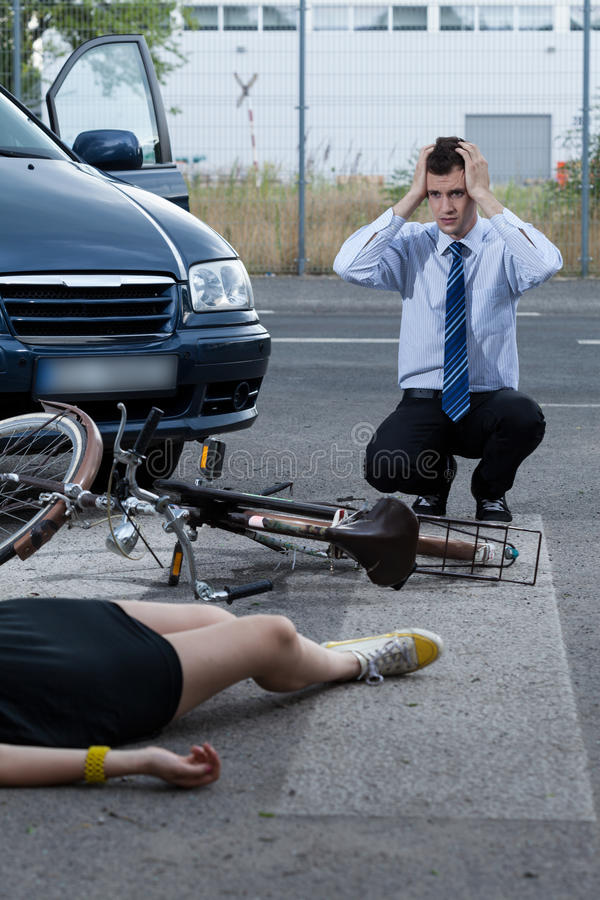 Woman after accident on bike stock images
