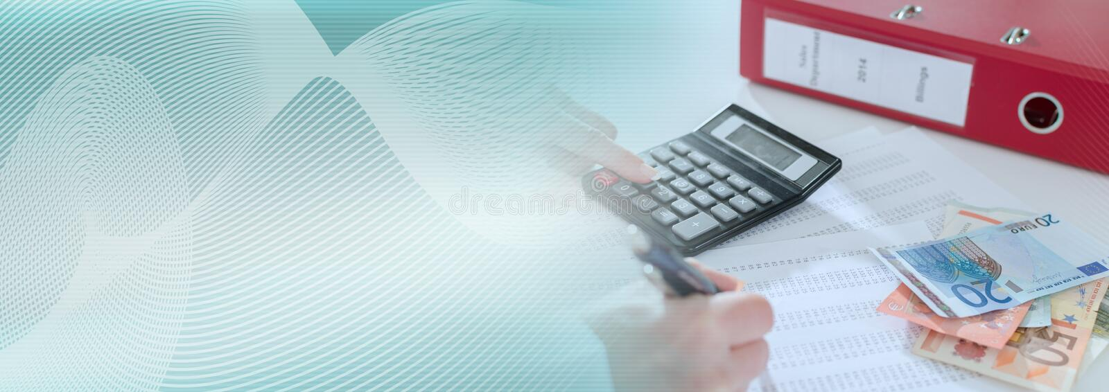 Woman accountant with calculator; panoramic banner royalty free stock photography