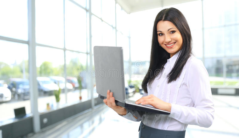 A woman administrator with laptop. Portrait of a woman administrator with laptop royalty free stock photos