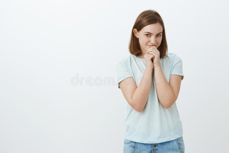 Woman admiring awesome popular guy in university feeling too shy to say hi. Tender feminine and gentle nice girl with stock photos