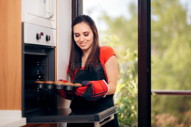 Woman Admiring her Delicious Cupcake fresh of the Oven stock photo