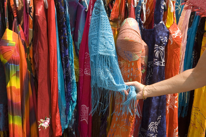 Woman admiring street vendors clothes stock image