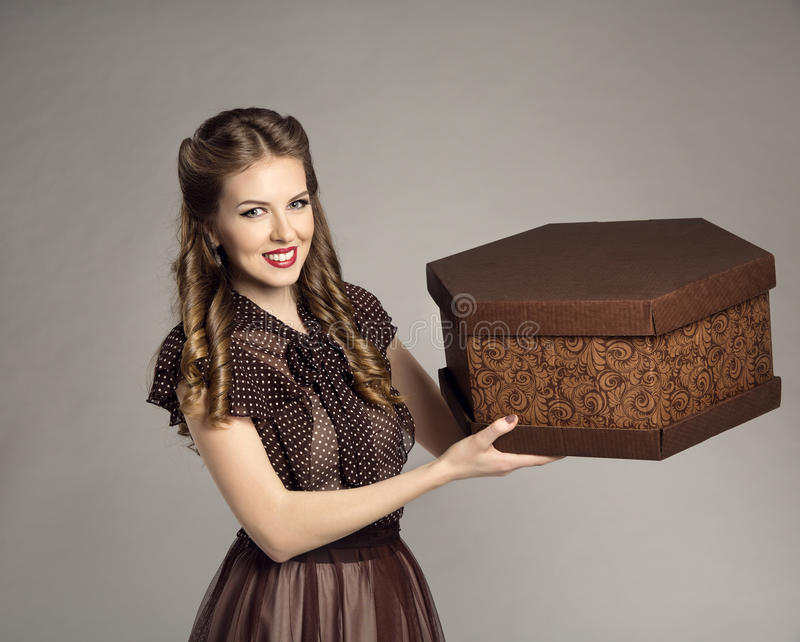 Woman Advertise Cake Present Gift Box, Retro Girl Food Deliver. Offer Delivery Service, Brown Cardboard Box over Gray Background royalty free stock photography