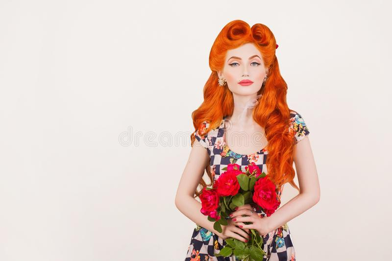 Woman advertise cosmetics. Amazed redhead model with vintage hairstyle in summer hat on pastel background copyspace. Red hair stock image