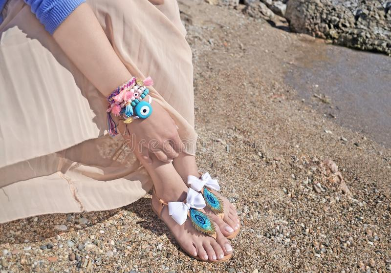 Greek sandals and jewelry advertisement on the beach stock photos