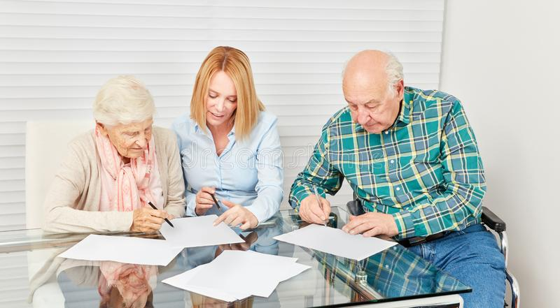 Woman advising senior citizen for finance. Or home insurance royalty free stock photography