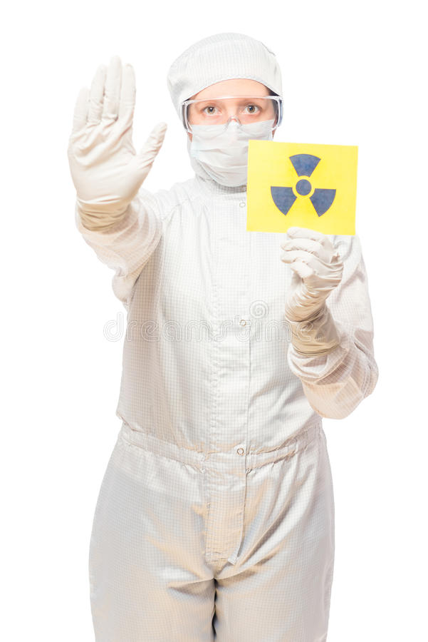 Woman in the affected area with radiation in a protective suit. With a sign of radiation royalty free stock photography