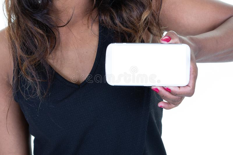 Woman african american holding empty screen smartphones on white background in closeup black hand royalty free stock images