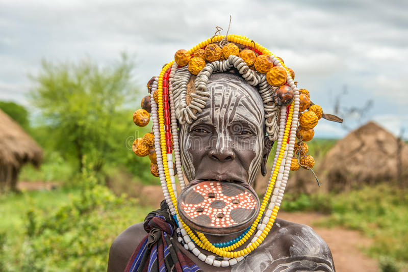 Woman from the african tribe Mursi in her village royalty free stock image