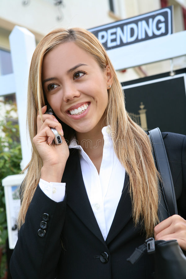 Woman Agent. A beautiful young real estate agent woman on the phone