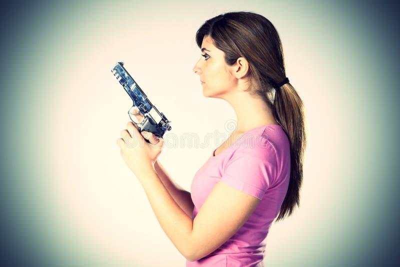 Woman aiming a handgun royalty free stock image
