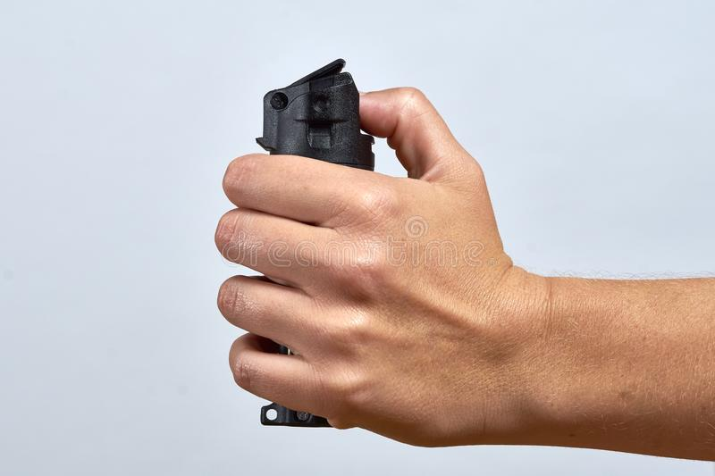 Female self defense. Woman aiming pepper spray for defense royalty free stock photo