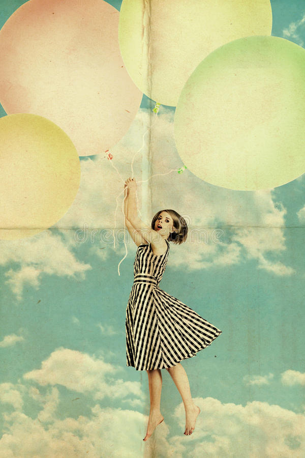 Woman on air balls in blue sky with clouds royalty free stock image