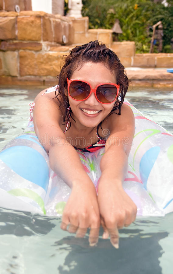 Download Woman on air bed stock photo. Image of female, holidays - 26099396