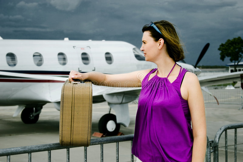 Woman and airplane royalty free stock image