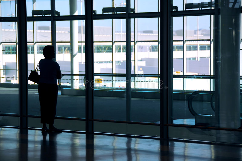 Woman airport stock photography