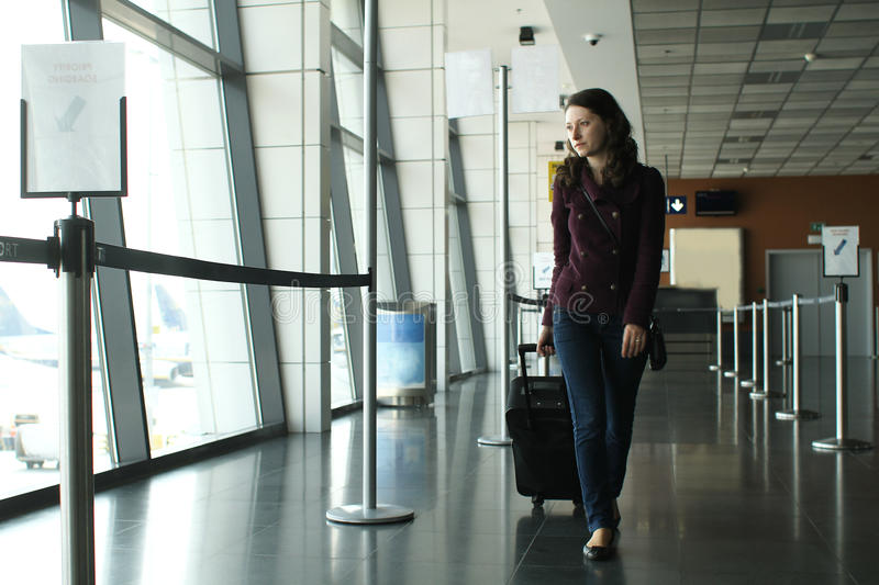 Woman in the airport stock photos