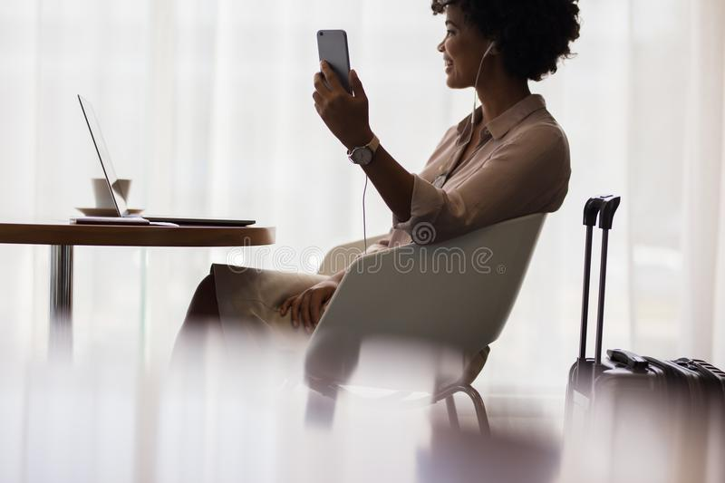 Woman at airport lounge making video call royalty free stock photos