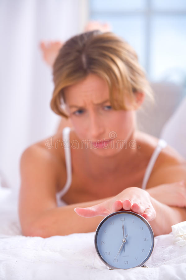 Download Woman with alarm clock stock photo. Image of bedroom - 11350390